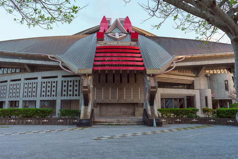 Japan-Okinawa-Naha-Food - Over the road from the military base is this theater shaped like a samurai helmet. I believe every Japanese city has one the same. Inside they mainly