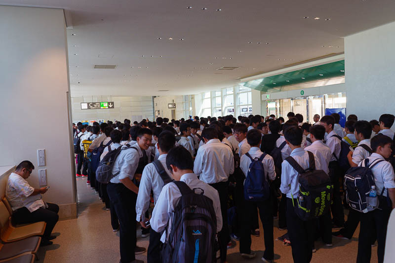 Japan-Okinawa-Fukuoka-Airport - Here is the line of school kids for security. It took forever. They were not on my flight but I presume the flight they were on was as horrific as the