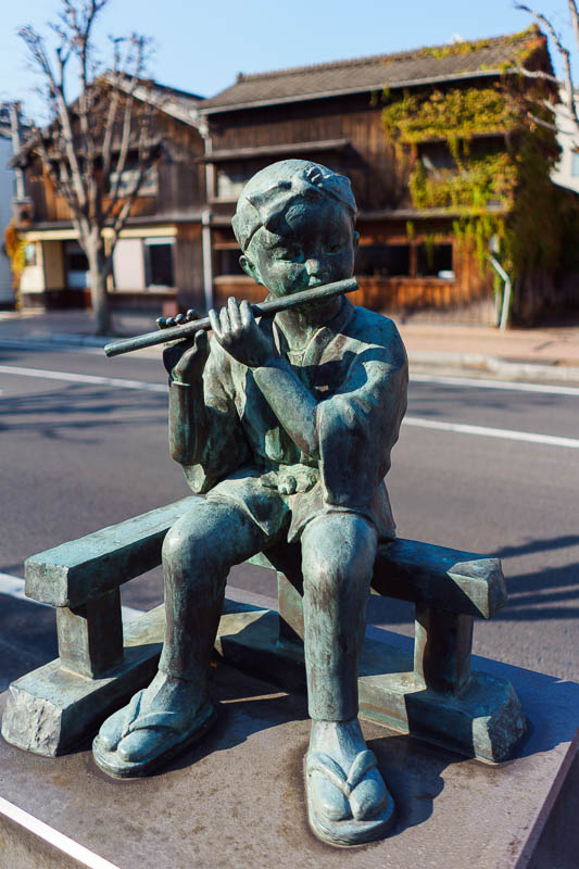 Japan-Karatsu-Castle-Hiking - The main street has lots of statues of boys playing flutes. I dont know what to think about this.