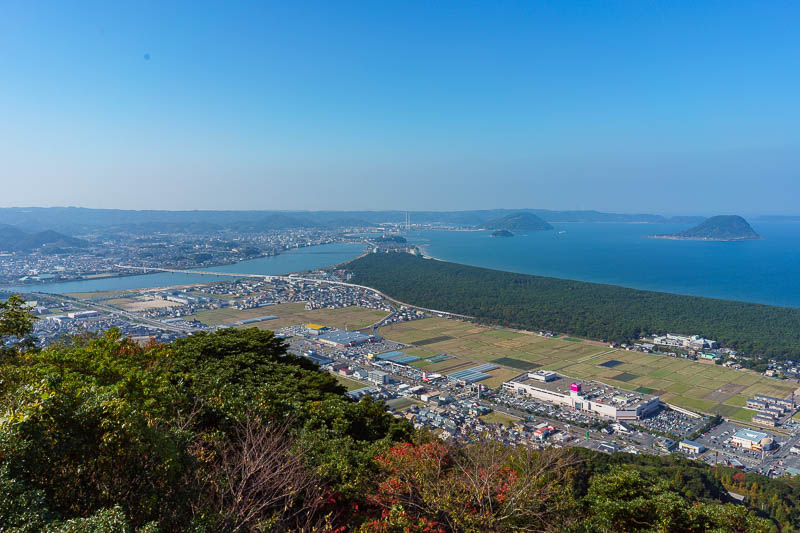 Japan-Karatsu-Castle-Hiking - Here you can see half the coastal pine forest, extending up the ISTHUMUS and over the bridge to the castle with the chimneys in the distance, basicall