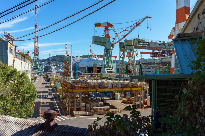 Japan-Nagasaki-Bridge-Tunnel - Here is the Mitsubishi heavy engineering ship building factory number 7. The whole complex goes for many miles, generally there is a huge fence. In th