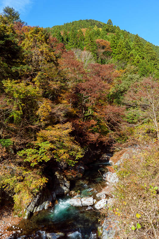Japan-Tokyo-Hiking-Mount Kawanori - The road followed this river with the blue water running over rocks.