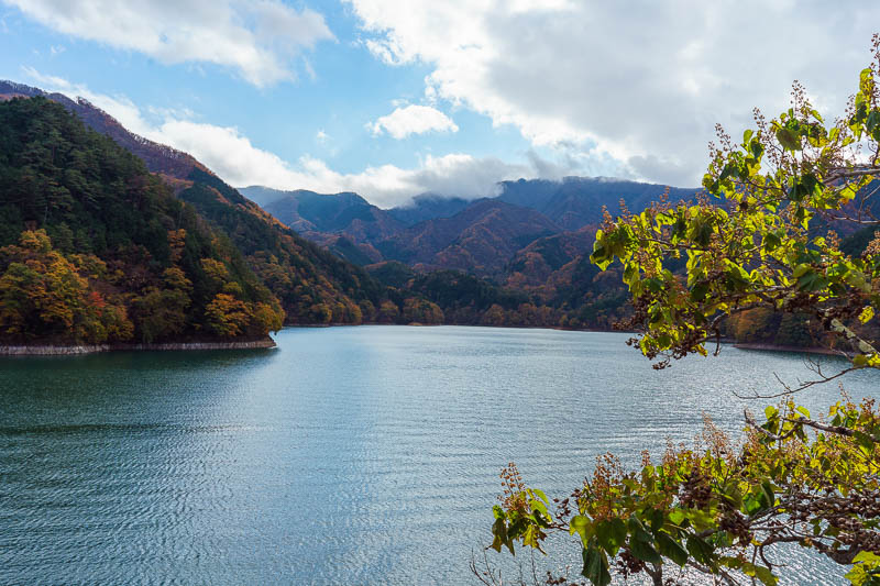Japan-Okutama-Lake-Hiking - More view. Despite the sun the cloud is still covering the tops of the mountains on the far side of the lake. I would run all the way around the edge