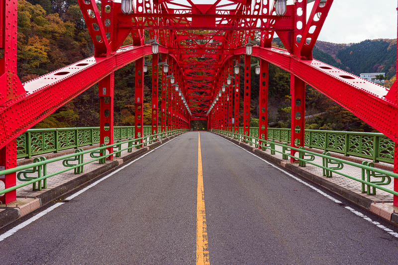 Japan-Okutama-Lake-Hiking - A red bridge is an opportunity for me to stand in the road again and hope the traffic behind me isnt a silent electric car I dont hear coming.
