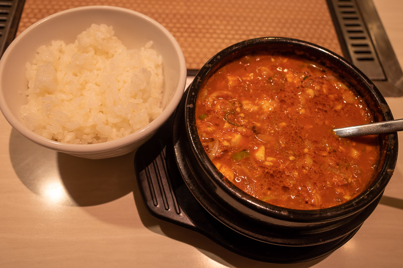 Japan-Takasaki-Food - I elected on the spicy raw horse and tofu stew. Negotiating what size rice I wanted had the waitress giggling uncontrollably for no apparent reason. S