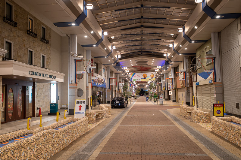 Japan-Niigata-Ramen - And right by my hotel, heres a modern covered shopping street. Very well lit. No people. Maybe tomorrow?