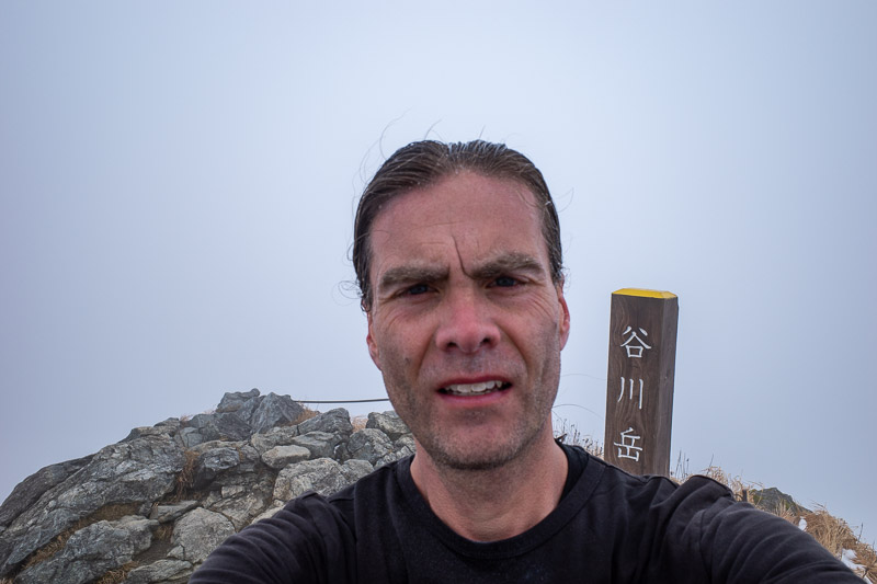 Japan-Hiking-Mount Tanigawa-Doai Station - Here I am on the summit. It was very windy on the summit, and very cold. I was ahead of schedule, but no time for happy snaps. I could not do THE STAN