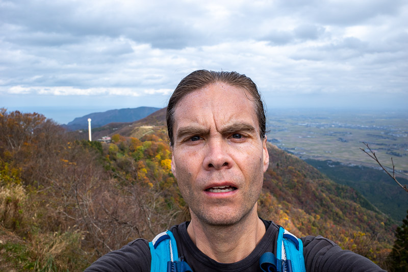 Japan-Niigata-Hiking-Mount Yahiko - Before we go look at the mystery pole, here is my head. Also a mystery as to how a head so large stays on my shoulders. That vein in my forehead still
