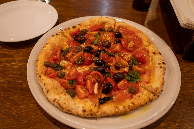 Japan-Yamagata-Food-Pizza - And here is my pizza, sans cheese, but with olives capers and tomatoes. I dont eat much meat because not eating meat offsets the carbon from my half w