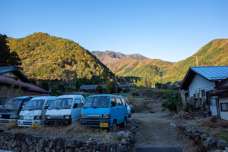 Japan-Tokyo-Hiking-Sasago-Mount Takigoyama - Back at the road! These minivans sit in front of the mountains I had just descended from in the late afternoon sun.