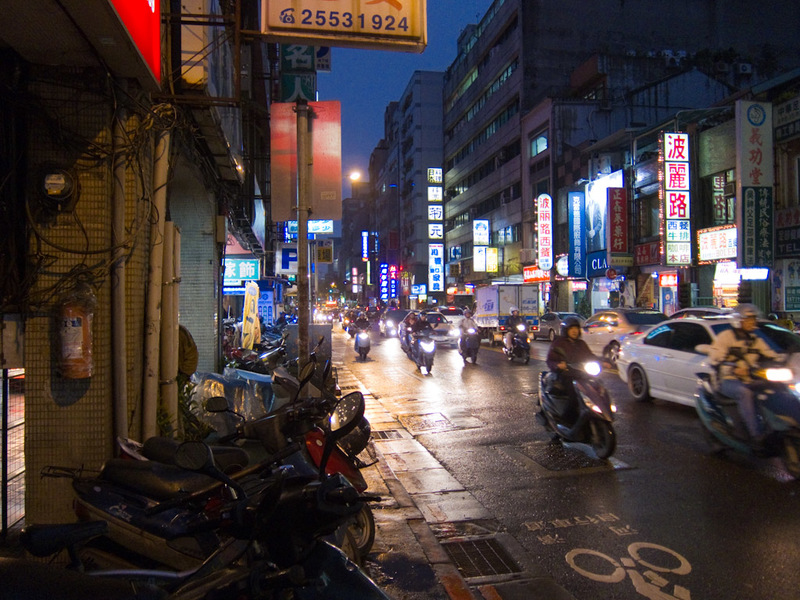 Taiwan-Taipei-Mall-Beef - A typical street scene, near my hotel. Lots of scooters and bright lights.