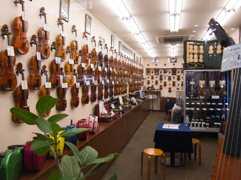 Japan-Tokyo-Shinjuku-Neon - This is just a random shop that sells nothing except violins. Theres many levels of violins.