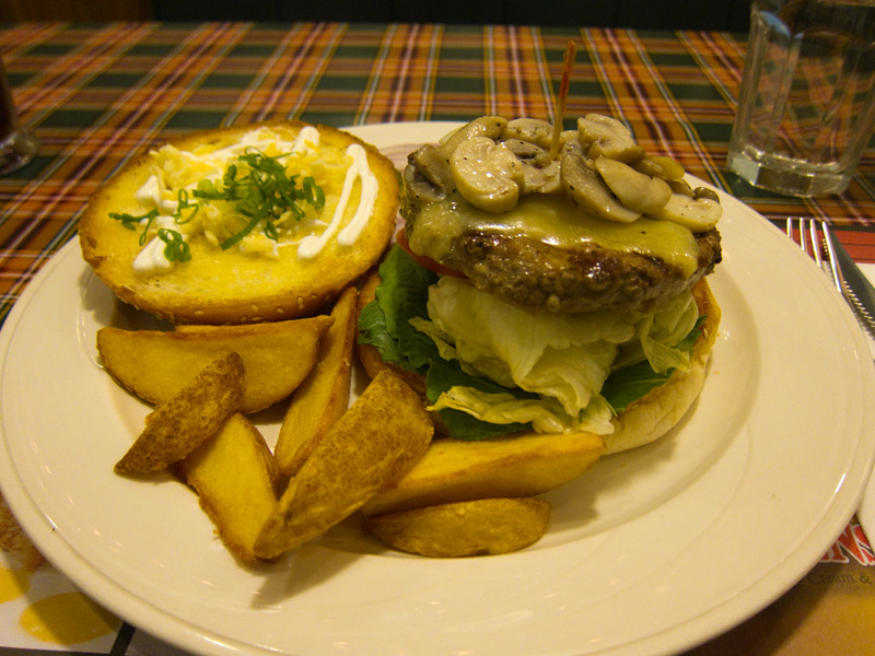 Taiwan-Taipei-Architecture-Taipei 101 - Second course, mushroom burger. It was pretty great! So were the chips with the skin left on.