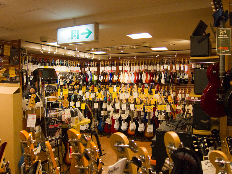 Japan-Osaka-Shinsaibashi-Guitar-Pizza - They even had Mayones guitars on the rack, I thought they were made to order.