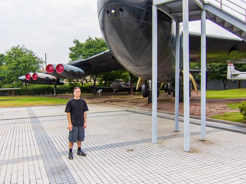 Korea-Seoul-Military-Musuem-Memorial - Me, standing in front of a B52. Whilst they arent as big as I imagined, I still cant figure out how they got it here. Surely they had to cut the wings
