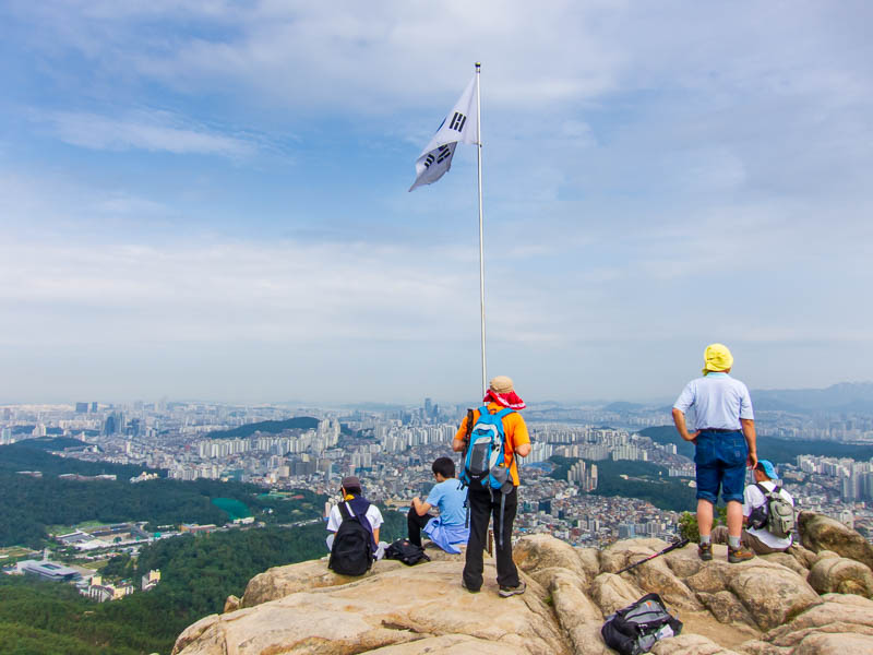 Korea-Seoul-Hiking-Gwanaksan - First summit, closest to Seoul, there are no guard rails anywhere, its a long way down off that rock. Getting to this part seemed to have no path at a