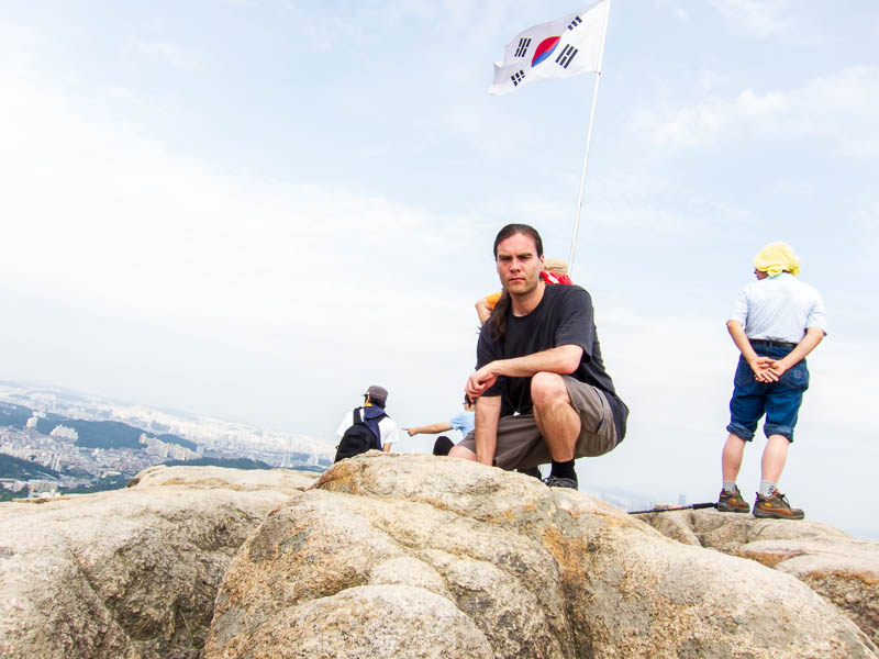 Korea-Seoul-Hiking-Gwanaksan - Its me, crouching down, I didnt really want to set the camera timer and step backwards off the cliff like so many idiots have done.