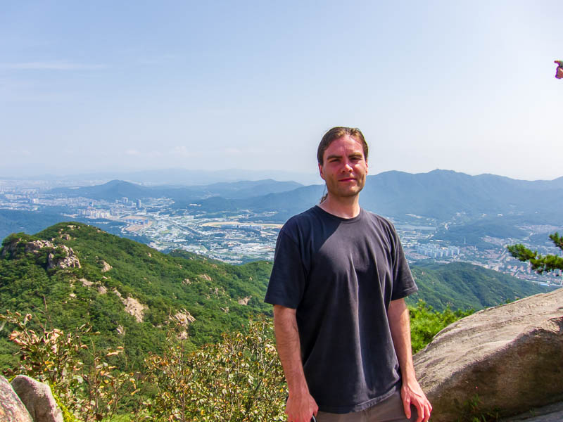 Korea-Seoul-Hiking-Gwanaksan - Me at the summit, a Korean guy took the photo for me and since he YELLED smile, I tried really hard.