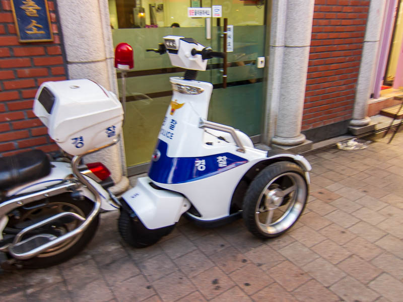 Korea-Seoul-Dongdaemun-Bibimbap - Seouls finest, to protect and to serve, on 3 wheeled idiot scooters.