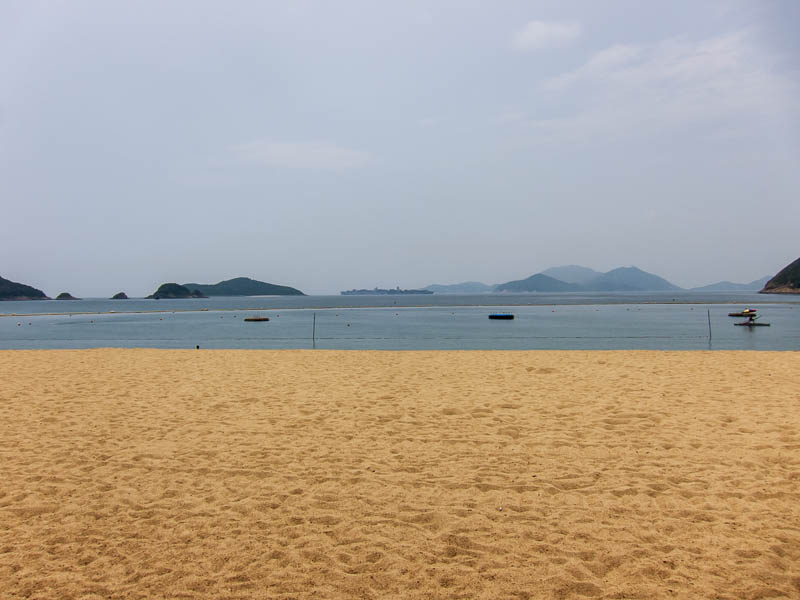 Hong Kong-Repulse Bay-Beach - The beach is picturesque, with the outlying islands and lots of big ships going past. The sand is not soft, its like the sand in Chennai, densely pack