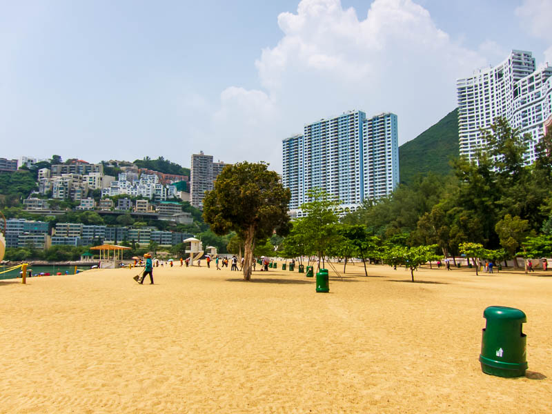 Hong Kong-Repulse Bay-Beach - I find it unusual that there are trees growing in the beach. Theres an army of people cleaning it constantly, more than there are people using the bea