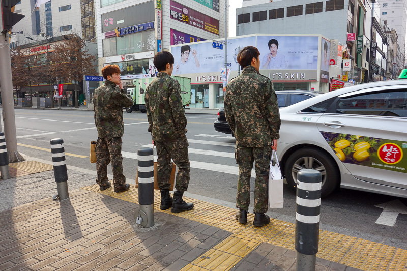 Korea-Daegu-Hiking-Apsan - Heres 3 Korean soldiers off to report for duty, carrying their beauty products.