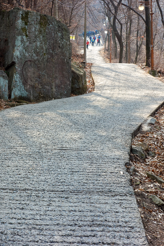 Korea-Daegu-Hiking-Apsan - This path is much much steeper than it looks. People coming down zig zag to slow themselves or go backwards. I found it to be an amazing calf workout.