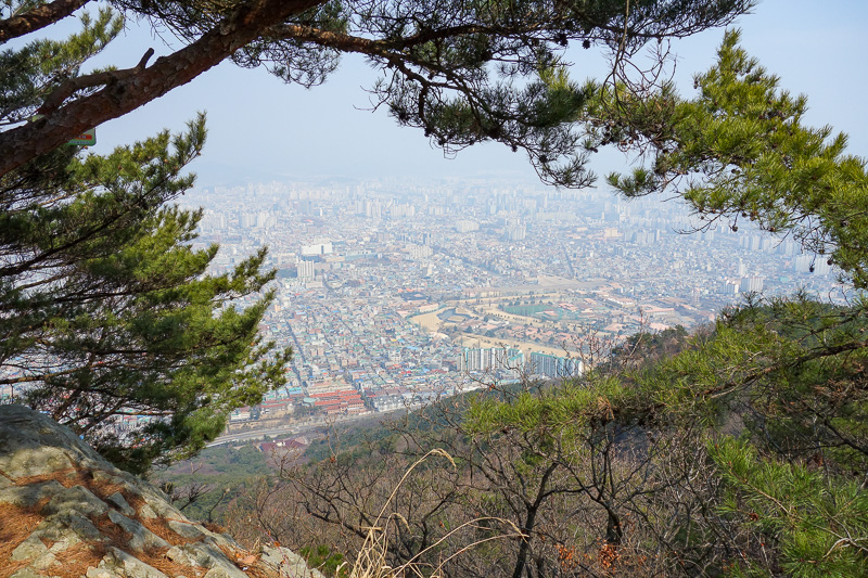 Korea-Daegu-Hiking-Apsan - About half way up, impressive view of the city below. Daegu is called 'the colorful city' however at the end of winter before trees grow back, its mos
