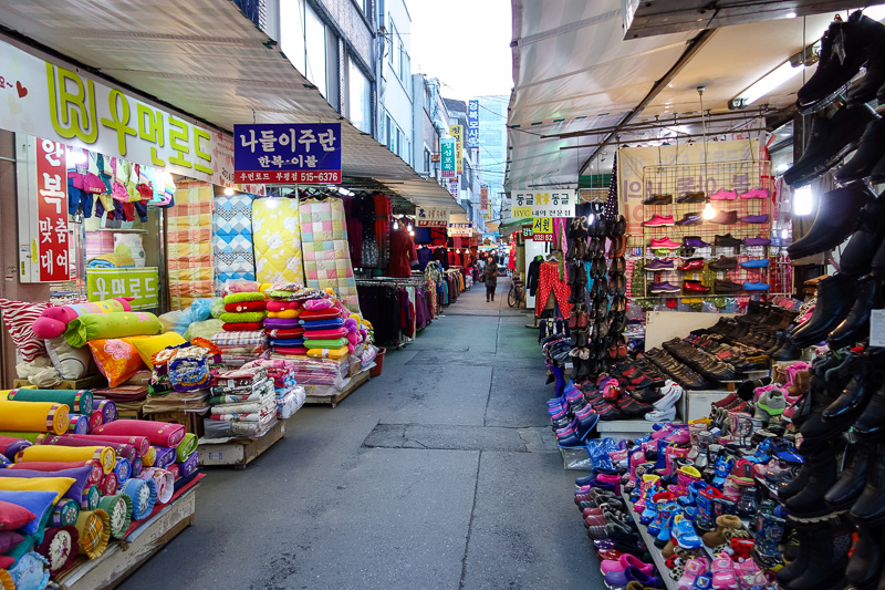 Korea-Bupyeong-Food-Dumplings - Above ground, and the fashion market is more of a ghost town. Except you can see the fashion being made, out the back, nannas are strapped to desks, w