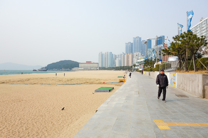 Korea-Busan-Beach-Haeundae - Looking along the beach back towards another part of Busan. Yesterday when I was looking down at the city on my many ridges ridge walk, I could not se