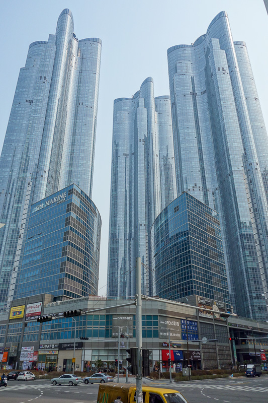 Korea-Busan-Beach-Haeundae - Impressive buildings. Theres a great promo video on youtube of a helicopter flying around in between them.