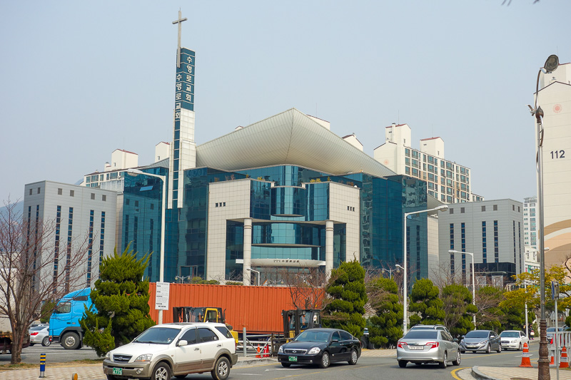 Korea-Busan-Beach-Haeundae - This is the local massive catholic church, in a wealthy area as we are by the beach and the yacht club. It is much bigger than the picture suggests, T