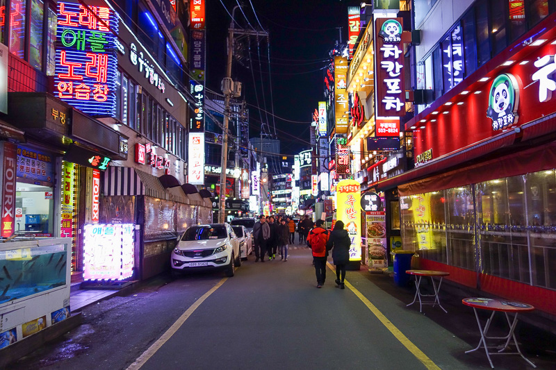 Korea-Bupyeong-Food-Dumplings - Random neon, the further you go the less stores, the more bars, and then the love hotels start. This is how the world works. You buy some poor girl so