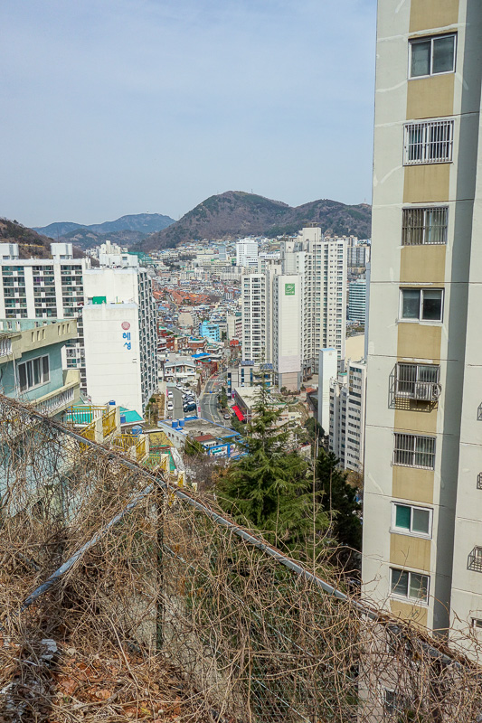 Korea-Busan-Beach-Songdo - Bonus photo of some more colorful houses going up a hill, the furthest peak here, I might be there tomorrow. Right now I am doing my washing which is