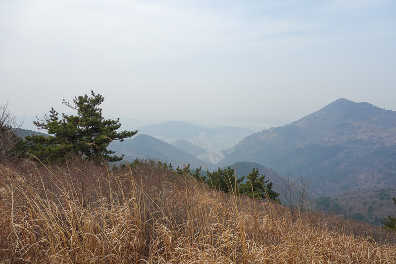 Korea-Busan-Hiking-Gudeoksan - Now I am somewhere along the ridge, looking back at the peak where the selfie was taken.