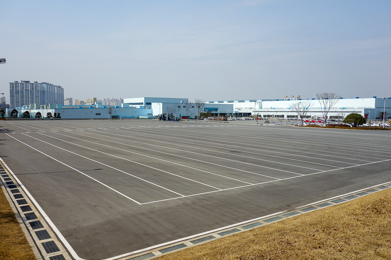Korea-Busan-Gwangju-Bus - A crooked shot of the local Kia car factory. Impressive looking, but no cars in the yard waiting to be exported.