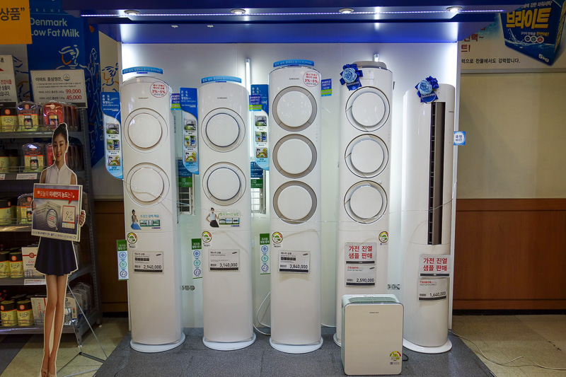 Korea-Gwangju-Rain-Uprising - It started raining so I went to another store. These are air purifiers. They are 6 feet tall and cost $3500 AUD. Cool.
