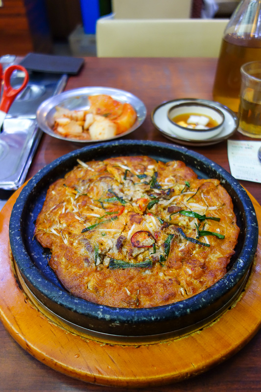 Korea-Seoul-Tower-Food-Pancake - At first glance you might find that to be a pizza. But its a kimchi pancake. Very good! I added lots of chilli flakes and pepper. Also this place prid