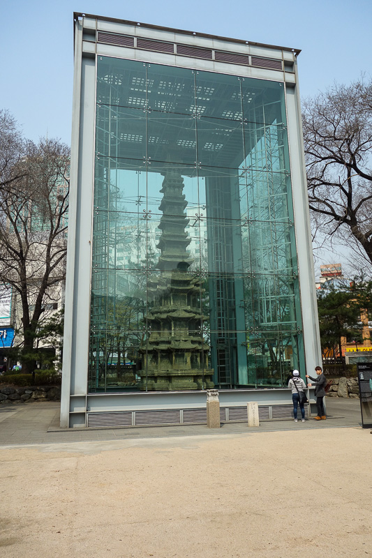 Korea-Seoul-Seodaemun Prison-Nakwon Arcade - Nearby is a genuine ancient pagoda. So genuine that it needs to be in a giant glass case. Most genuine things in Asia are genuine re creations.