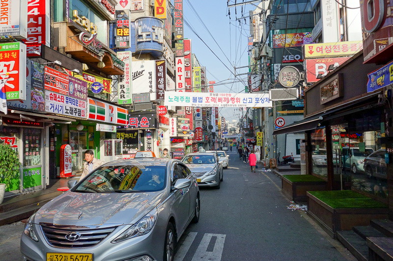 Korea-Seoul-Hiking-Bukhansan-Baegundae - One of the streets I walked along instead of catching the bus. Eventually hiking gear shops appeared, thousands of them. Not as nice and shiny new lik