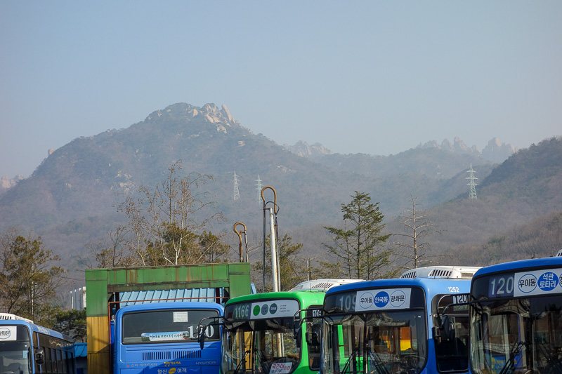 Korea-Seoul-Hiking-Bukhansan-Baegundae - I think the highest peak is in the centre here, behind the one in the foreground. Nice yellow sand. If you take public transport, its on foot from her