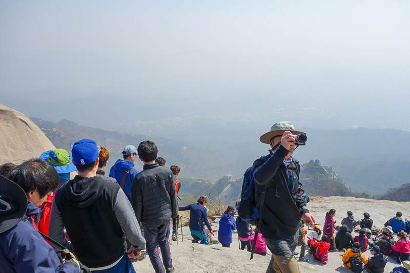 Korea-Seoul-Hiking-Bukhansan-Baegundae - The busy summit area. People all amazingly happy.