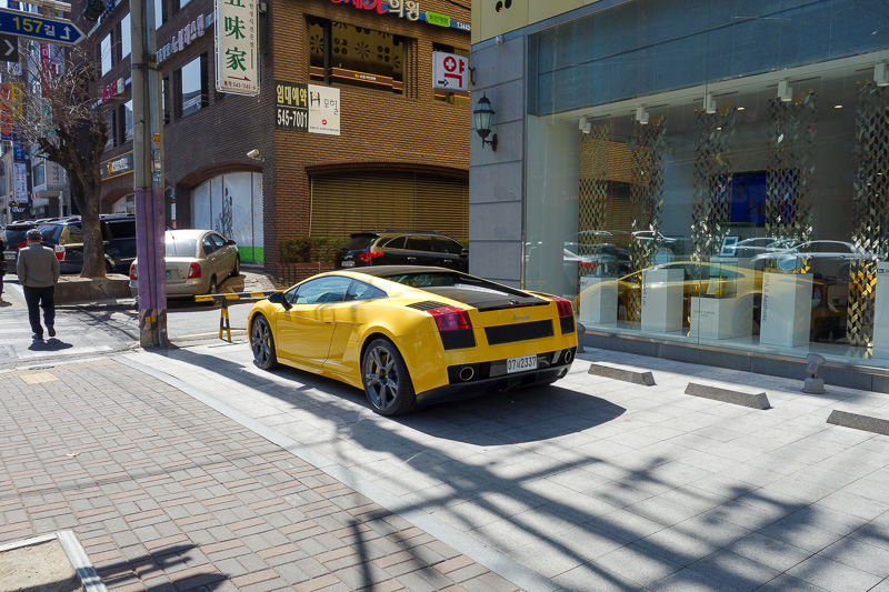 Korea-Seoul-Gangnam-Insadong-Mall - Theres fancy cars everywhere all over Gangnam, but this one is parked on the footpath across numerous parks out the front of a surgery that says it sp