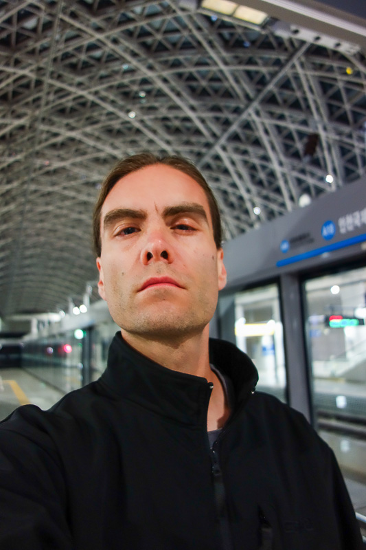 Sydney-Incheon-Boeing 777 - Its me, waiting for the airport train, looking pleased. Apparently they are building a maglev that goes around in a bullshit circle for tourists to go