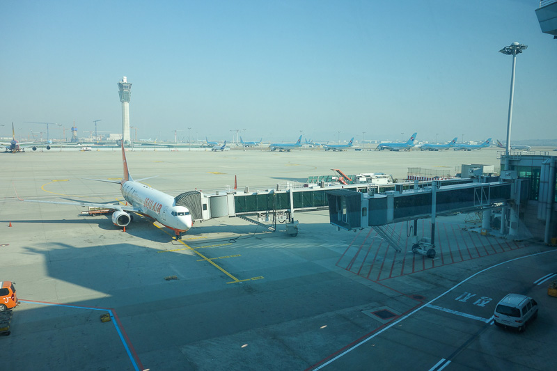 Korea-Seoul-Incheon-Airport - Apron through tinted glass. Lots of Blue Korean airlines planes. Told you this would be boring.