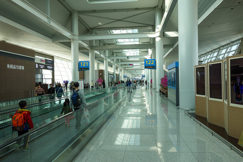 Korea-Seoul-Incheon-Airport - The concourse terminal. Looks like they are changing ownership of many of the shops here. It was still busy, I picked an un busy bit to show as I walk