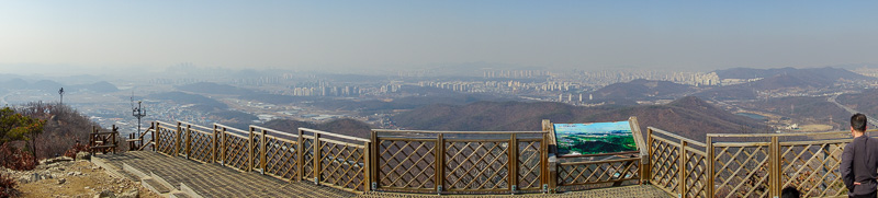 Korea-Hiking-Incheon - Heres a panorama from the top, looking back in the direction from where I had come. At about this time I was again subjected to 20 questions by a rand