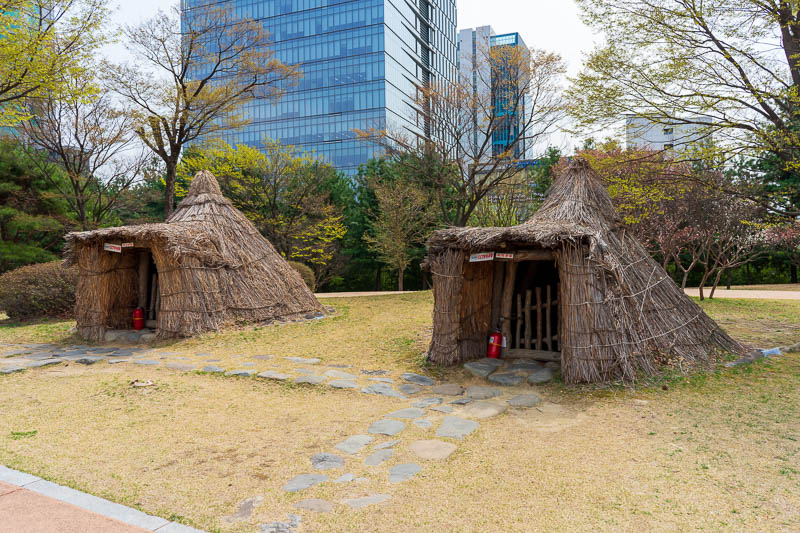 Korea-Daejeon-Expo - On my return journey I passed yet another park, this one is a prehistoric park, complete with straw huts with cctv.