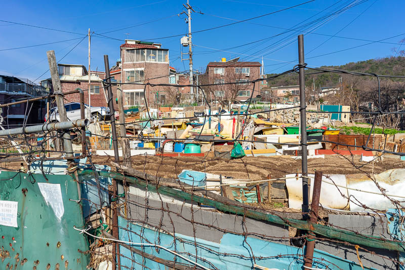Korea-Hiking-Suraksan - Walking to the start of the trail from the station meant passing lots of houses busy collecting rubbish and storing it in their yards in case theres e