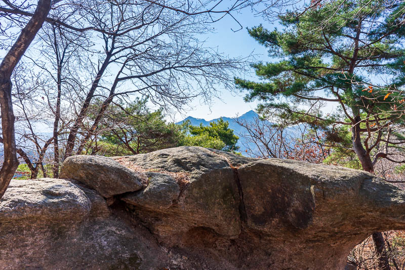 Korea-Hiking-Suraksan - Oh look, its another mountain as seen from this mountain. I fear the sky is too blue, I tried to make it less blue.